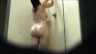 Voyeur finds a voluptuous amateur brunette taking a shower