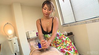 Cute babe Aika massages a long fat cock with her warm mouth