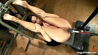 brunette babe having a blast with several fucking machines