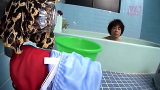 Japanese milf toys her pussy in the shower
