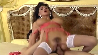 Sensational and insatiable brunette busty babe rides on a big white shaft