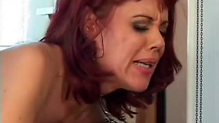 Smoking hot redhead in stockings takes a ride on the delivery boy