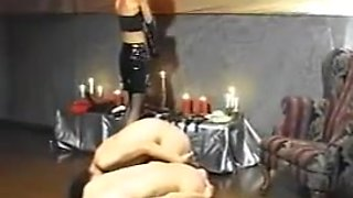 Japanese mistress plays with 2 slaves