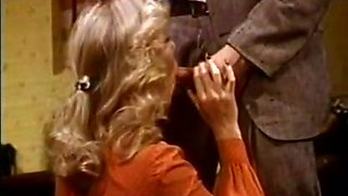 Bosomy blonde gives her lover a great blowjob right in his office