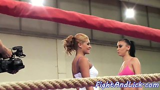 Lesbian babes wrestling in a boxing ring
