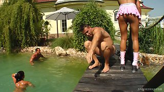 Natalia and another horny bitch banged in the pool