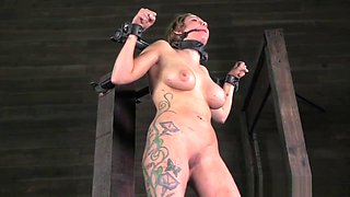 Busty slave restrained and tormented