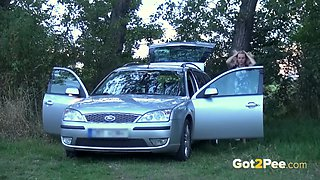Blonde Pissing - Naughty housewife cleans the car with her golden pee