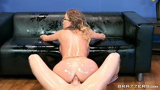 Britney Amber covered in oil before riding a stud's penis