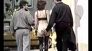 Vintage public BDSM movie of a hot brunette slave