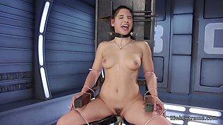 Tied up babe has fun on fucking machine