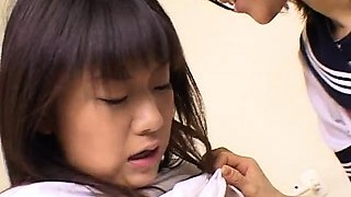 Kinky Japanese schoolgirls share a cock and a strap-on toy