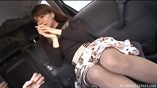 Long haired Japanese brunette babe gets her pussy toyed with in a car