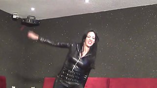 Latex mistress whips two male slaves