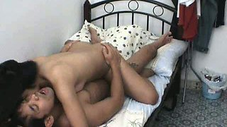 Adorable girlfriend rides her boyfriend on her small dorm bed