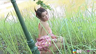 Thai model shows off pretty outfits and bikinis outdoors