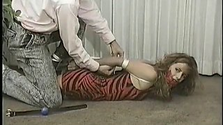 woman bound and ballgagged