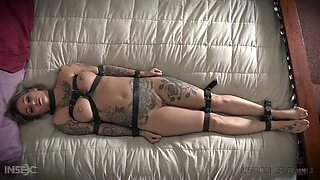 This tattooed chick knows what leather strap bondage is all about