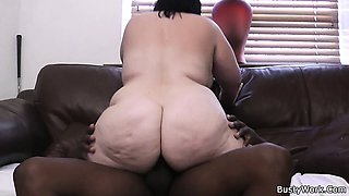 Big tits woman in fishnets rides black cock