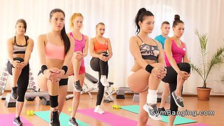 Dude bangs two hot babes at the gym