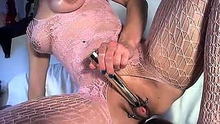 Masked nympho in lingerie fingers and toys her aching cunt