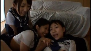 Three adorable Asian schoolgirls share a stiff cock in POV
