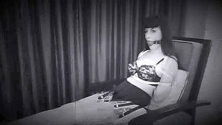 An emo girl is being tied up and abused roughly on a webcam