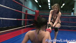 Busty lezzies wrestling and fingering pussies