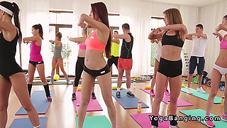 Fitness coach bangs slim busty brunette on pilates ball