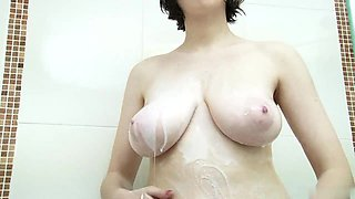 Luisa gets foamy in shower and take of bathing suit