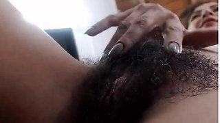 Hairy MILF Runs her Fingers through her Bush