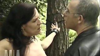 Mature slave punished outdoors