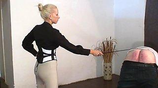 slave gets caned by strict blonde mistress