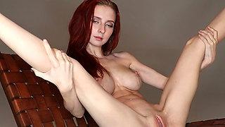 Svelte rather flexible redhead Helga Grey has got inviting tight pussy