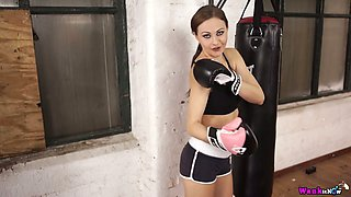 Sweet looking boxer babe Tina Kay is stripping and playing with her tits