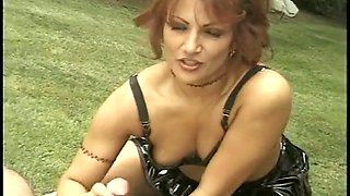 Hot redhead milf in latex dress outside blowing with dick