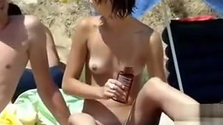 Shaved tight pussy and tiny tits on the nude beach