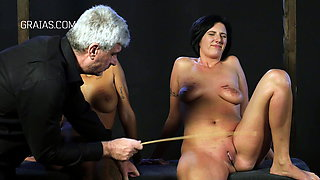 Caning and clamps right on the clit of slaves