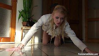 Kate rolls around on the floor touching her wet slit