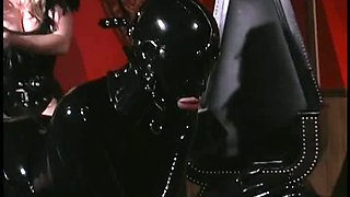 This slave looks good in latex catsuit and she is no stranger to BDSM sessions