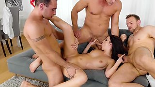 Insolent brunette works three guys in a wild play