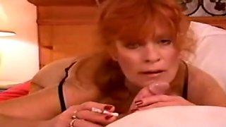 Sexy Cougar Giving Blowjob While Smoking
