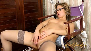 babe in sexy glasses strips down and strokes her clit