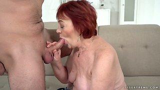 Short red haired mature slut Marsha is still good at riding dick