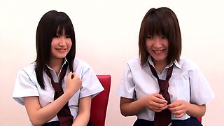 Alluring Oriental schoolgirls in uniform expose themselves