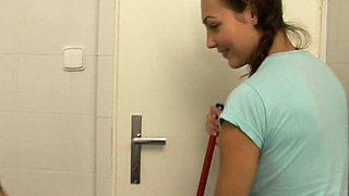 Naughty girl licks another in a toilet