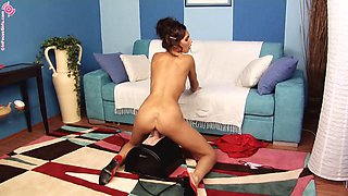 Classy babe in a red dress riding on the Sybian like never before