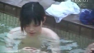 Nude Japanese girls get caught on a hidden cam in a pool