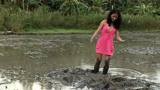Petite Filipina Jane trashes her slutty little dress in a muddy rice paddy