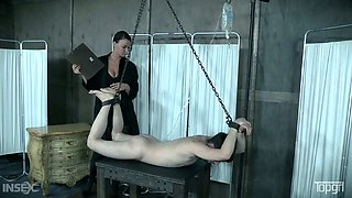 Wickedly hot mistress with huge beautiful tits has her male slave tied up